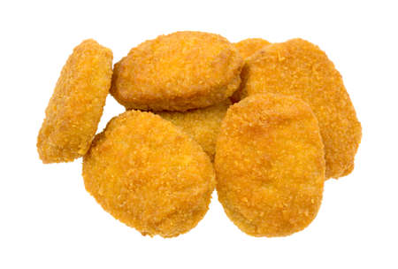 Several pieces of cooked breaded chicken pieces on a white background  Banco de Imagens