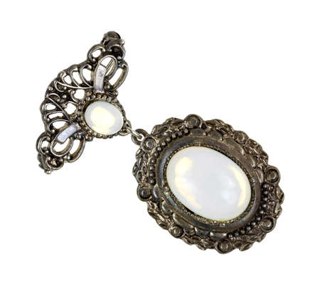mother of pearl: Top view of an old brooch with mother of pearl gemstones on a white background