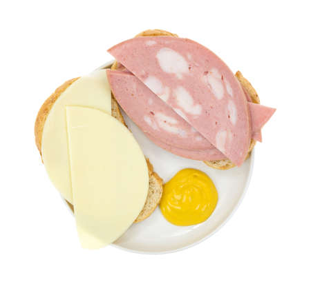 Top view of an open-faced mortadella sandwich on Italian bread with provolone cheese and mustard
