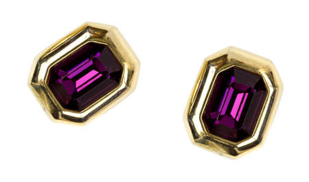 Two imitation gemstone earrings with gold setting on a white background. Imagens
