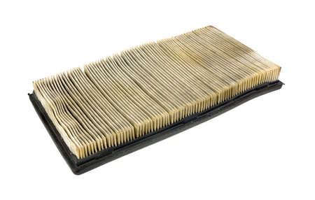 rubber gasket: Side view of a used and dirty automobile air filter on a white background