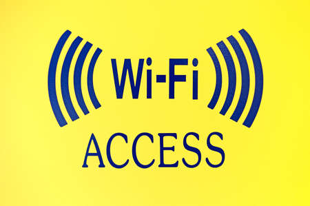 A bold wifi Access sign on a bright yellow background