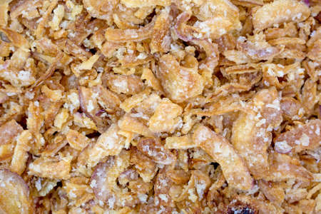 A very close view of deep fried onion pieces