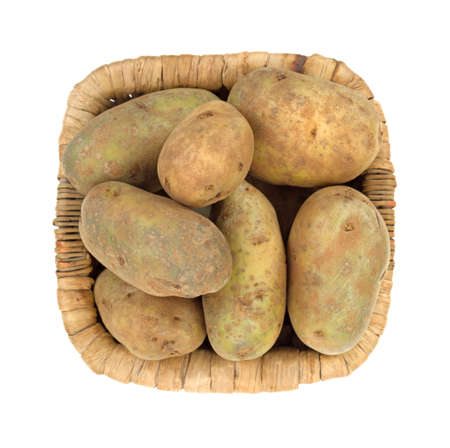russet potato: Top view of a group of russet potatoes in a wicker basket