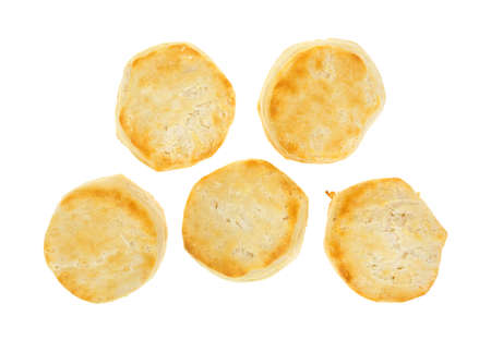 Top view of five freshly baked buttermilk biscuits on a white background  photo