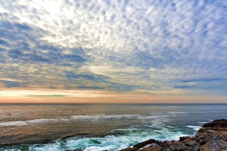 The north Atlantic Ocean washing onto the rock ledges in the early morning light at Pemaquid Point, Maine