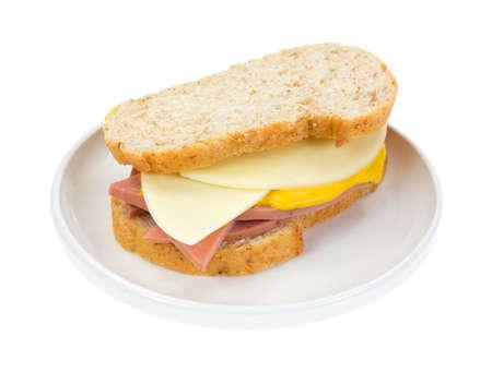 A mortadella sandwich with provolone cheese and mustard on Italian bread
