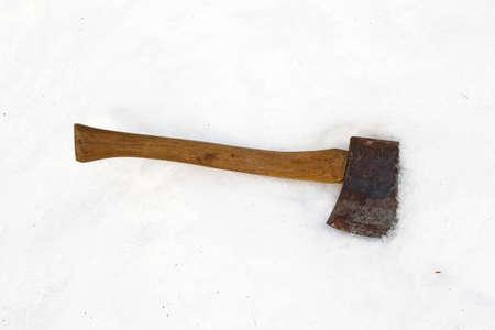 snowbank: An old wood handle ax atop a snowbank. Stock Photo