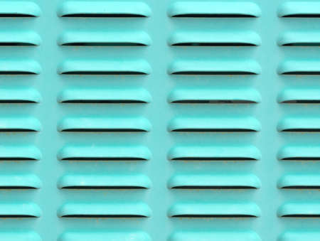 vents: Close view of air vents on the side of a large industrial generator.