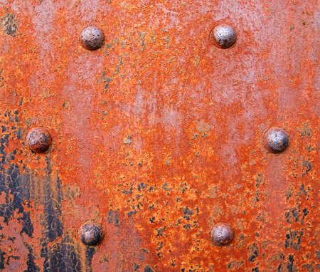 rivets: Close view of a very rusty girder with bolted rivets