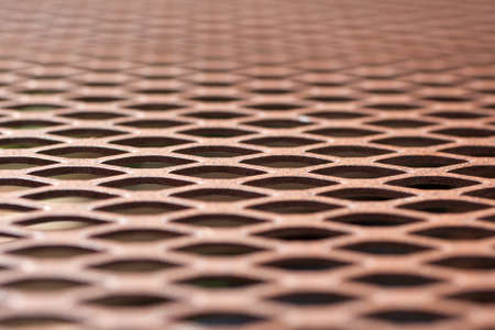 wire mesh: A very close view of a brown wire mesh table top.