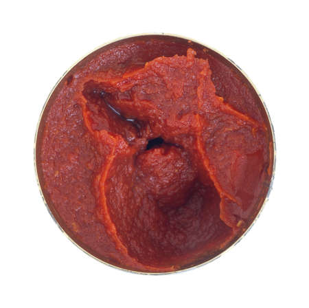 Top view of an opened can of tomato paste on a white background.