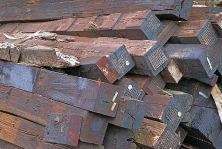 creosote: A group of railroad ties covered in creosote.
