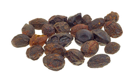 diuretic: A group of dried saw palmetto berries on a white background. Stock Photo