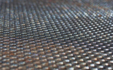 wire mesh: A very close view of an old black wire mesh table top.