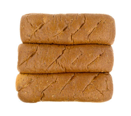 multi grain sandwich: Top view of a group of freshly baked whole wheat sub rolls on a white background.