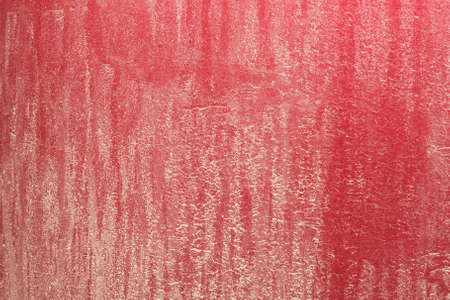 A very close view of an exceptionally dirty red car rear bumper. Stock Photo