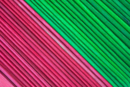 hues: A very close view of several rows of holiday craft sticks in green and red holiday hues. Stock Photo