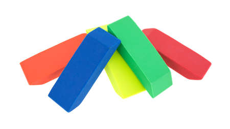 Orange, blue, yellow, green and red erasers arranged on a white background.
