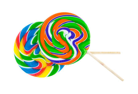 Two very colorful lollypops with wood stick handles on a white background.