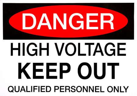 danger: A Danger, High Voltage safety sign in bold lettering. Stock Photo