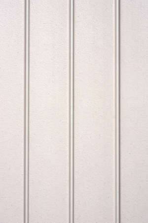 tongue and groove: A background of plastic siding with inset horizontal grooves.