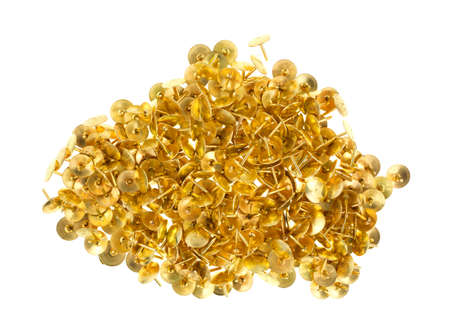 A small group of gold thumbtacks on a white background. photo