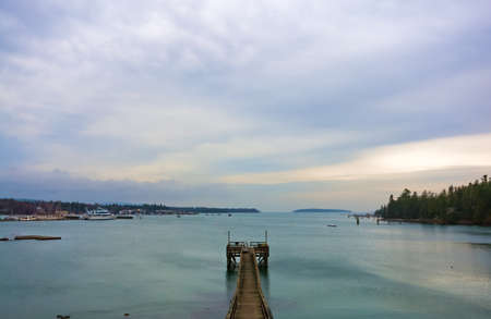 Wide view of Southwest Harbor, Maine with a pier in the foreground. Stock Photo