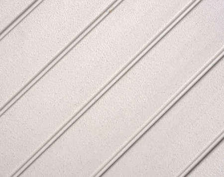 tongue and groove: A background of plastic with inset grooves at an acute angle. Stock Photo