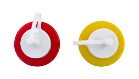 Top view of plastic mustard and ketchup bottles on a white background.