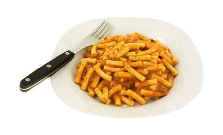 ground beef: A plate of canned ground beef in a tomato sauce with pasta plus fork to the side on a white background. Stock Photo