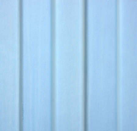 wall covering: A close view of painted blue galvanized steel siding showing wear. Stock Photo