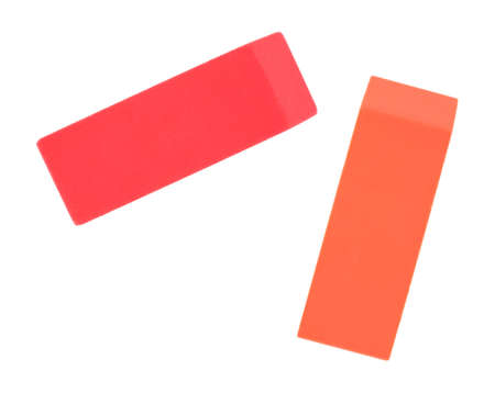 A red and orange eraser on a white background.
