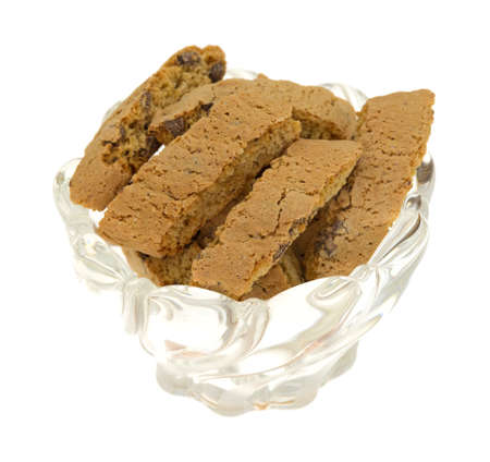 twice: A leaded glass bowl filled with fresh cantuccini chocolate chip biscuits on a white background. Stock Photo