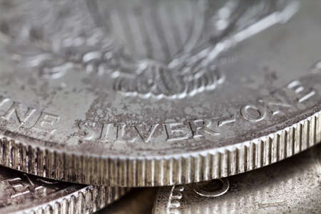 fine silver: A very close view of a one ounce fine silver dollar. Stock Photo
