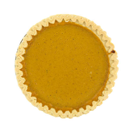 Top view of a freshly baked sugar free pumpkin pie on a white background. Banco de Imagens