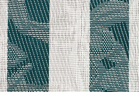 Close view of woven plastic lawn furniture covering.