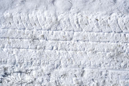 traction: A close view of tire tracks in hard packed snow. Stock Photo