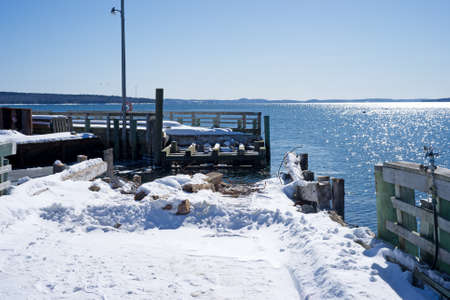 public works: Repairing of a town pier in the winter time at Searsport Maine.