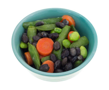 buttered: Assorted buttered cooked vegetables in a small bowl isolated on a white background.
