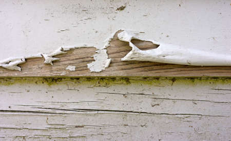 clapboard: Close view of badly peeling paint on old clapboard siding. Stock Photo