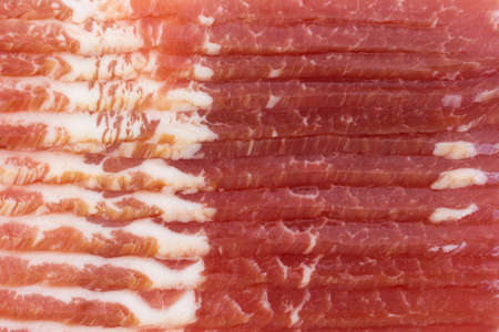 uncooked bacon: A very close view of smoked low sodium bacon. Stock Photo
