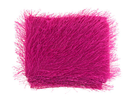 white trim: New roll of fuchsia fuzzy fashion trim fabric that has been opened on a white background.
