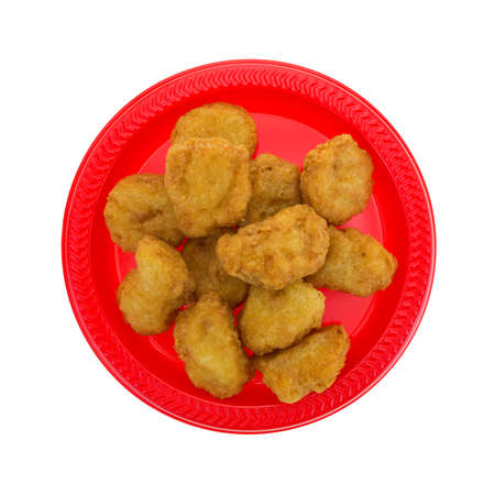 chicken nuggets: Top view of a serving of chicken nuggets on a red plate isolated on a white background. Stock Photo