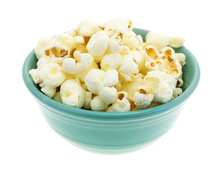 popcorn bowls: A small bowl filled with a serving of white cheddar cheese flavored popcorn isolated on a white background.