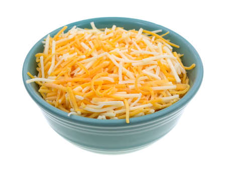 A small bowl filled with shredded white cheddar, sharp cheddar and mild cheddar cheeses isolated on a white background.
