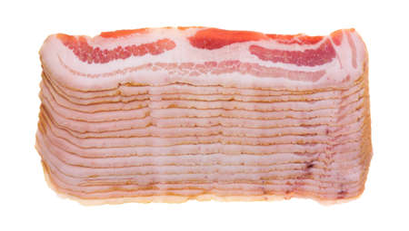 uncooked bacon: Several rows of sliced fatty bacon isolated on a white background.