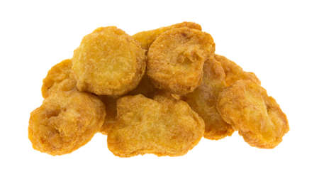 chicken nuggets: Several chicken nuggets in a small pile isolated on a white background. Stock Photo