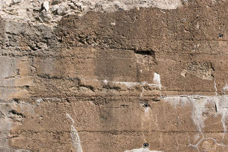 retaining: An old retaining wall that is eroding with age. Stock Photo