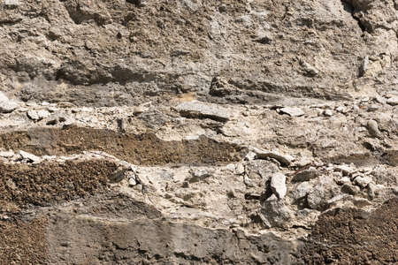 crumbling: An old retaining wall that is crumbling with age. Stock Photo